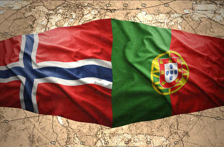 Waving Norwegian and Portuguese flags of the political map of the world photo