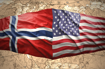 Waving Norwegian and American flags of the political map of the world Stock Photo