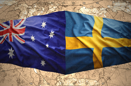 Waving Swedish and Australian flags of the political map of the world photo