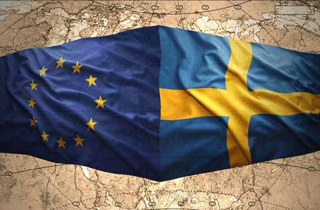 Waving Swedish and European Union flags of the political map of the world photo
