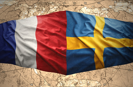Waving Swedish and French flags of the political map of the world photo