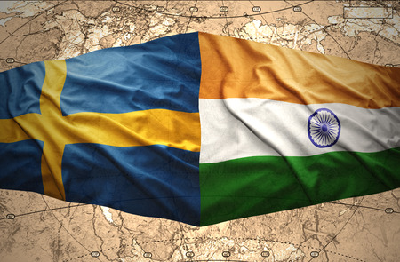 Waving Swedish and Indian flags of the political map of the world photo