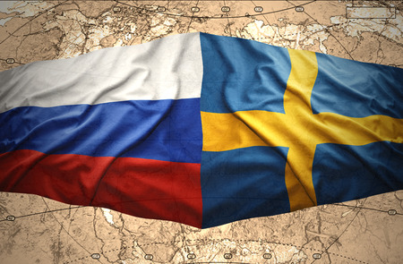 Waving Swedish and Russian flags of the political map of the world photo