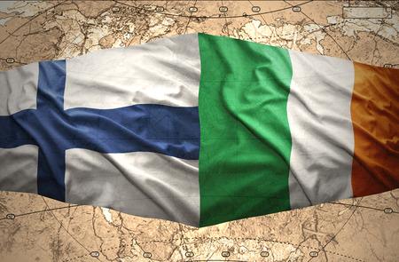 irish map: Waving Finnish and Irish flags of the political map of the world Stock Photo
