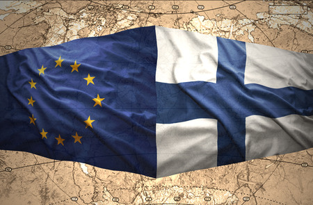 Waving Finnish and European Union flags of the political map of the world photo