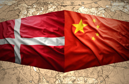Waving Danish and Chinese flags of the political map of the world photo
