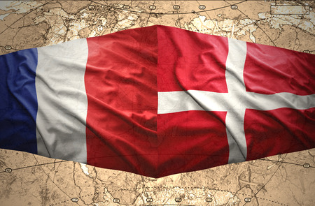 Waving Danish and French flags of the political map of the world photo