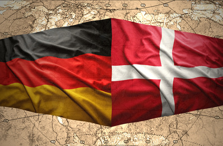 Waving Danish and German flags of the political map of the world photo
