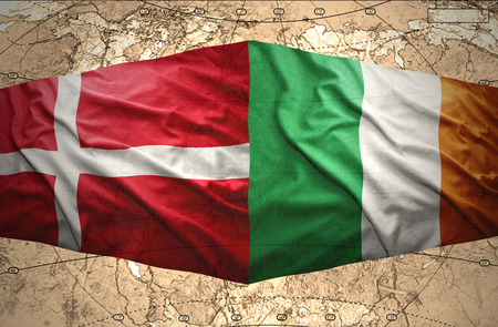 Waving Danish and Irish flags of the political map of the world photo
