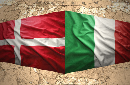 Waving Danish and Italian flags of the political map of the world photo