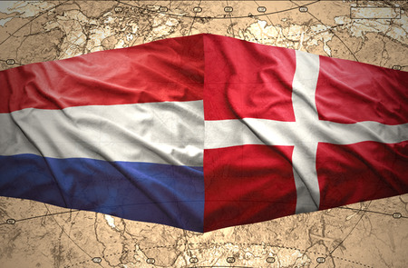 Waving Danish and Dutch flags of the political map of the world photo