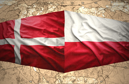 Waving Danish and Polish flags of the political map of the world photo