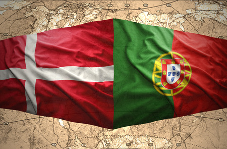 Waving Danish and Portuguese flags of the political map of the world photo