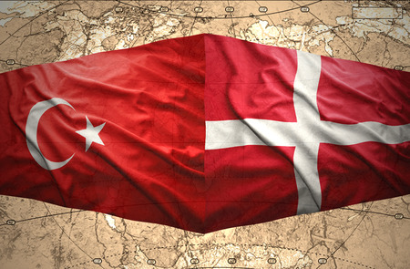 Waving Danish and Turkish flags of the political map of the world photo