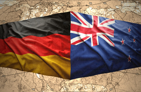 east berlin: Waving New Zealand and German flags of the political map of the world