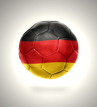Football ball with the national flag of Germany on a gray background photo