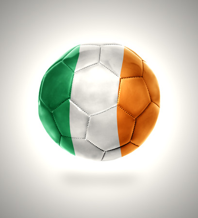 Football ball with the national flag of Ireland on a gray background photo