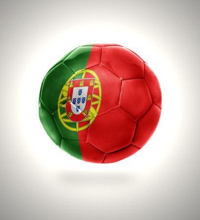 Football ball with the national flag of Portugal on a gray background photo