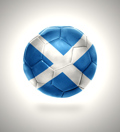 Football ball with the national flag of Scotland on a gray background photo