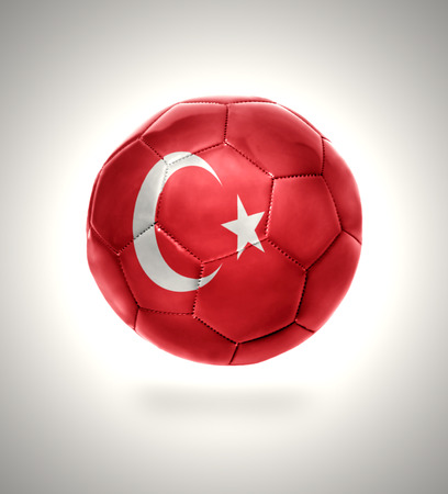 Football ball with the national flag of Turkey on a gray background photo