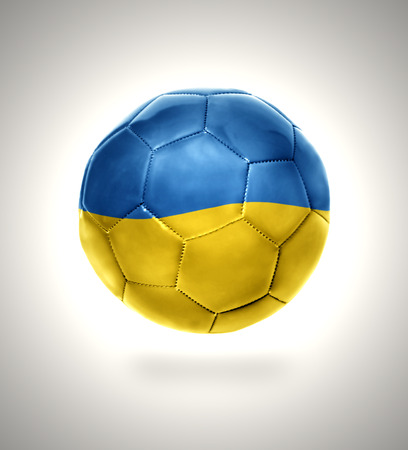 Football ball with the national flag of Ukraine on a gray background photo