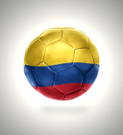la bandera de colombia: Bal�n de f�tbol con la bandera nacional de Colombia sobre un fondo gris
