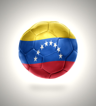 Football ball with the national flag of Venezuela on a gray background photo