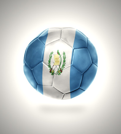 Football ball with the national flag of Guatemala on a gray background photo