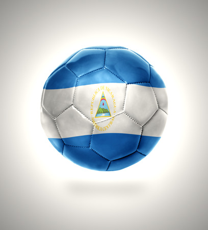 Football ball with the national flag of Nicaragua on a gray background photo
