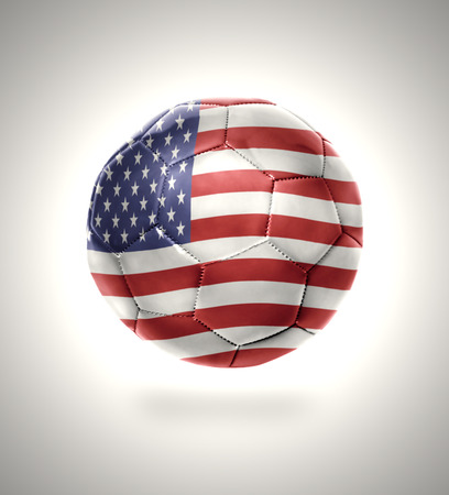 Football ball with the national flag of American on a gray background photo