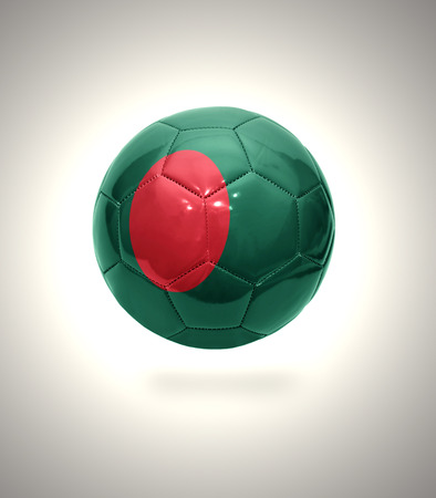 Football ball with the national flag of Bangladesh on a gray background photo