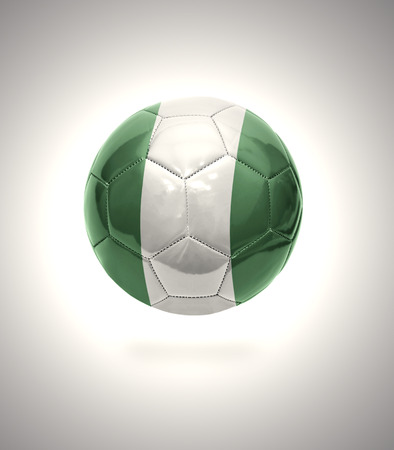 Football ball with the national flag of Nigeria on a gray background