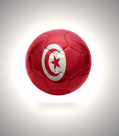Football ball with the national flag of Tunisia on a gray background photo