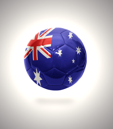 Football ball with the national flag of Australia on a gray background photo