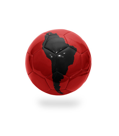 Football ball with the map of South America on white background photo