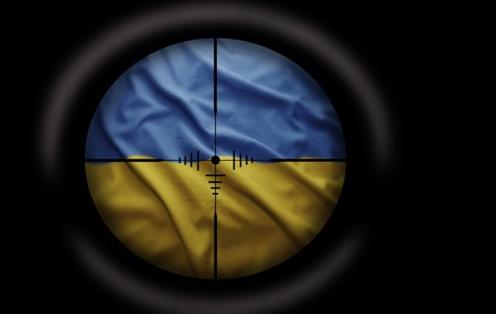 Sniper scope aimed at the Ukrainian flag photo