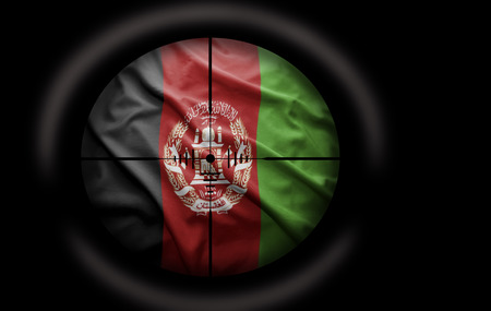 afghan flag: Sniper scope aimed at the Afghan flag Stock Photo
