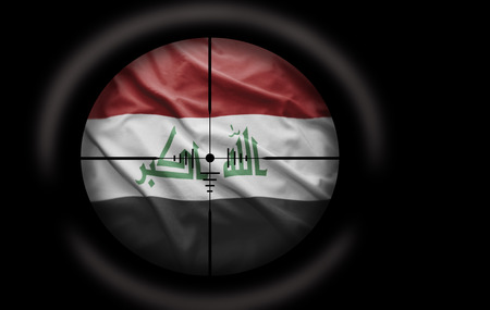 Sniper scope aimed at the Iraqi flag photo
