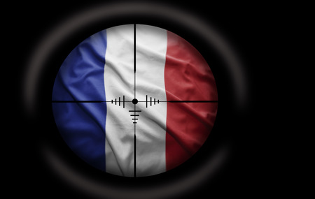 rebel flag: Sniper scope aimed at the French flag Stock Photo