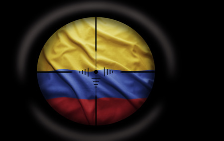 rebel flag: Sniper scope aimed at the Colombian flag Stock Photo