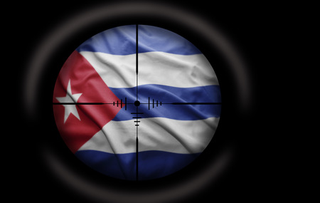 Sniper scope aimed at the Cuban flag photo