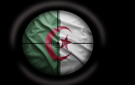 Sniper scope aimed at the Algerian flag photo