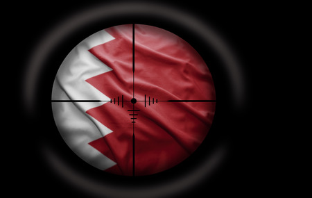 Sniper scope aimed at the Bahraini flag photo