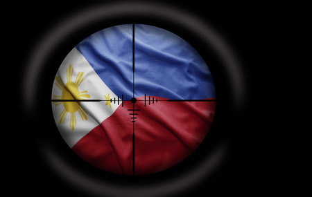nationalism: Sniper scope aimed at the Philippine flag