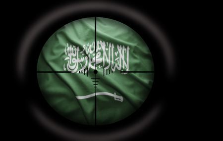 Sniper scope aimed at the Saudi Arabia flag photo