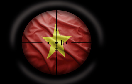 Sniper scope aimed at the Vietnamese flag photo