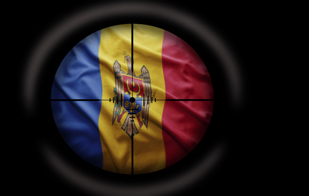 Sniper scope aimed at the Moldovan flag photo