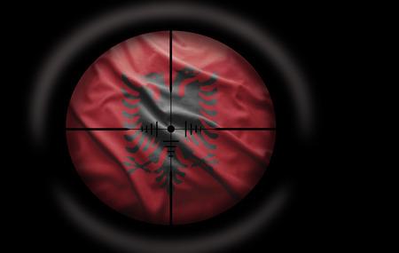 albanian: Sniper scope aimed at the Albanian flag Stock Photo