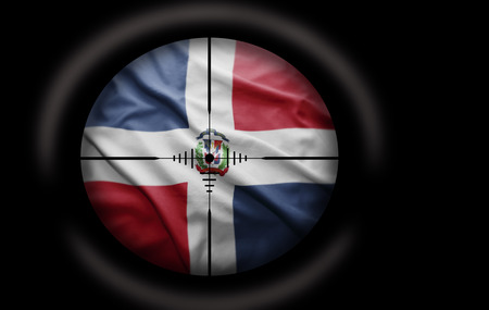 Sniper scope aimed at the Dominican flag photo