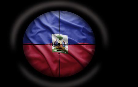 haitian: Sniper scope aimed at the Haitian flag Stock Photo